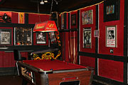 interior view of pool table and pinball machine
